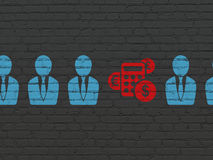 Business concept: calculator icon on wall. Business concept: row of Painted blue business man icons around red calculator icon on Black Brick wall background, 3d Royalty Free Stock Photography