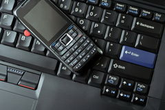 Business concept cell phone and laptop Royalty Free Stock Image