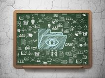 Business concept: Folder With Eye on School board background. Business concept: Chalk Blue Folder With Eye icon on School board background with  Hand Drawn Royalty Free Stock Image