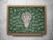 Business concept: Light Bulb on School board background. Business concept: Chalk Pink Light Bulb icon on School board background with  Hand Drawn Business Icons Royalty Free Stock Photo