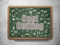 Business concept: Cost Cutting on School board background. Business concept: Chalk Pink text Cost Cutting on School board background with  Hand Drawn Business Stock Photos