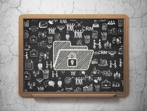 Business concept: Folder With Lock on School board background. Business concept: Chalk White Folder With Lock icon on School board background with  Hand Drawn Royalty Free Stock Photo