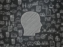Business concept: Head on School board background. Business concept: Chalk White Head icon on School board background with  Hand Drawn Business Icons, School Royalty Free Stock Photo