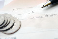 Business concept with check, coins and pen Royalty Free Stock Photography