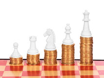 Business concept with chess and coins Stock Images