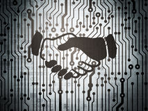 Business concept: circuit board with Handshake Stock Photo