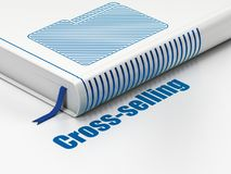 Business concept: book Folder, Cross-Selling on white background. Business concept: closed book with Blue Folder icon and text Cross-Selling on floor, white Stock Image