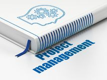 Business concept: book Head With Gears, Project Management on white background. Business concept: closed book with Blue Head With Gears icon and text Project Royalty Free Stock Photos