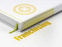 Business concept: book Target, Franchising on white background. Business concept: closed book with Gold Target icon and text Franchising on floor, white Stock Image