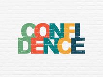 Business concept: Confidence on wall background. Business concept: Painted multicolor text Confidence on White Brick wall background Royalty Free Stock Photo