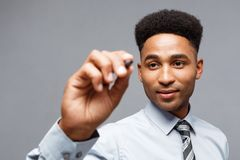 Business Concept - Confident African American Business manager prepared to write on virtual board or glass in office. Business Concept - Confident African Royalty Free Stock Images