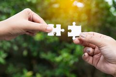 Business concept - Connect jigsaw pieces to create network connection stock images