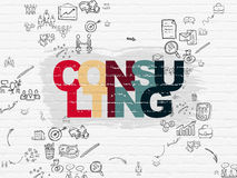 Business concept: Consulting on wall background. Business concept: Painted multicolor text Consulting on White Brick wall background with Scheme Of Hand Drawn Royalty Free Stock Photos