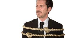Business concept, crisis. A tied up businessman, business concept, crisis stock video