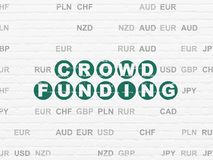 Business concept: Crowd Funding on wall background. Business concept: Painted green text Crowd Funding on White Brick wall background with Currency Royalty Free Stock Images