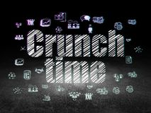 Business concept: Crunch Time in grunge dark room. Business concept: Glowing text Crunch Time,  Hand Drawn Business Icons in grunge dark room with Dirty Floor Royalty Free Stock Images