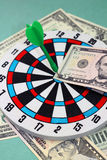 Business concept. Dart hit 5-dollar banknote Stock Photo