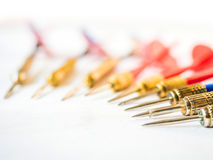 Business concept with darts pointing to the same target Stock Images
