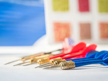 Business concept with darts pointing to the same target Royalty Free Stock Photo