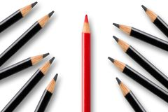 Business concept of disruption, leadership or think different; red pencil dividing group of black pencils stock photo