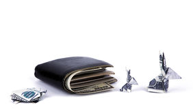 Business concept : Dollar currency origami  rabbit and  turtle with old black wallet. On the white background Royalty Free Stock Photography