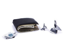 Business concept : Dollar currency origami  rabbit and  turtle with old black wallet. On the white background Stock Photos
