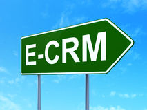 Business concept: E-CRM on road sign background Stock Images