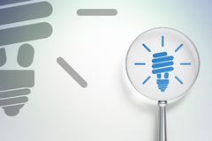 Business concept:  Energy Saving Lamp with optical glass on digital background. Business concept: magnifying optical glass with Energy Saving Lamp icon on Stock Photos