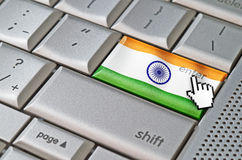 Business concept enter India. Business concept mouse cursor pressing India enter key on metallic keyboard Stock Photography