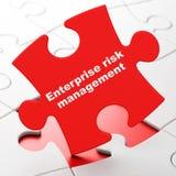 Business concept: Enterprise Risk Management on puzzle background. Business concept: Enterprise Risk Management on Red puzzle pieces background, 3D rendering Stock Image