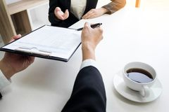 Business concept - Executives at desk discussion sales performance in a office royalty free stock image