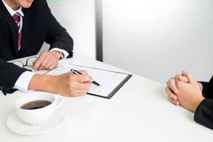 Business concept - Executives at desk discussion sales performance in a office royalty free stock photo