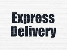 Business concept: Express Delivery on wall background. Business concept: Painted black text Express Delivery on White Brick wall background Royalty Free Stock Photo