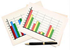 Business concept with finance graphs and black pen Stock Photos