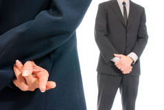 Business concept fingers crossed boss isolated. Business concept fingers crossed in front of boss isolated on white background Royalty Free Stock Photo
