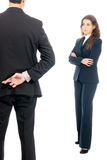 Business concept fingers crossed in front of boss. Isolated on white background Stock Image