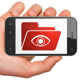 Business concept: Folder With Eye on smartphone Stock Photo