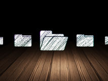 Business concept: folder icon in grunge dark room. Business concept: row of Glowing folder icons around folder icon in grunge dark room Wooden Floor, dark Stock Photo