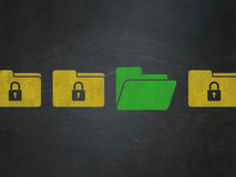 Business concept: folder icon on School Board. Business concept: row of Painted yellow folder with lock icons around green folder icon on School Board background Royalty Free Stock Photography