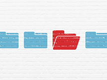 Business concept: folder icon on wall background. Business concept: row of Painted blue folder icons around red folder icon on White Brick wall background, 3d Stock Image