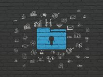 Business concept: Folder With Keyhole on wall background. Business concept: Painted blue Folder With Keyhole icon on Black Brick wall background with  Hand Drawn Royalty Free Stock Photos