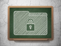 Business concept: Folder With Lock on chalkboard background Royalty Free Stock Image