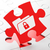 Business concept: Folder With Lock on puzzle Royalty Free Stock Photo