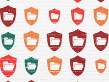 Business concept: Folder With Shield icons on wall Stock Images