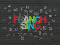 Business concept: Franchising on wall background. Business concept: Painted multicolor text Franchising on Black Brick wall background with  Hand Drawn Business Stock Images