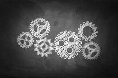 Business concept: Gears on chalkboard background.  Stock Photography