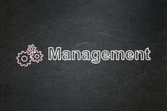Business concept: Gears and Management on. Business concept: Gears icon and text Management on Black chalkboard background, 3d render Stock Images
