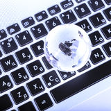 business concept of  glass globe on a laptop keyboard Royalty Free Stock Image