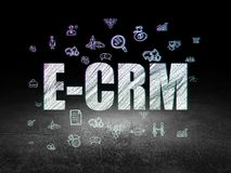 Business concept: E-CRM in grunge dark room. Business concept: Glowing text E-CRM,  Hand Drawn Business Icons in grunge dark room with Dirty Floor, black Stock Image