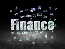 Business concept: Finance in grunge dark room. Business concept: Glowing text Finance,  Hand Drawn Business Icons in grunge dark room with Dirty Floor, black Stock Photography